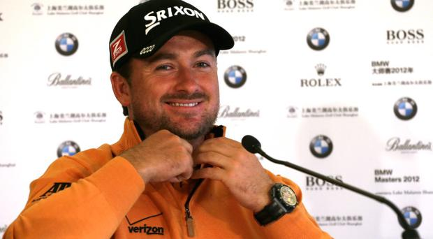 SHANGHAI, CHINA - OCTOBER 24: Graeme McDowell of Northern Ireland looks on in a press conference during the Pro Am event prior to the start of the BMW Masters at Lake Malaren Golf Club on October 24, 2012 in Shanghai, China. (Photo by Mark Wieland/Getty Images)