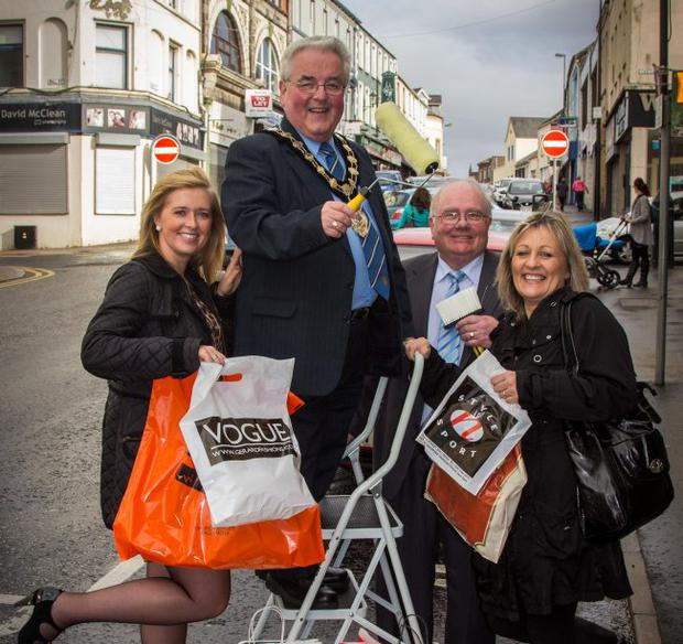 Mayor of Ballymena, Alderman P.J. McAvoy (centre left) gets his paint roller at the ready as he helps Willie Alexander, Revitalise Programme Steering Group (centre right); Grace Gillen, Ballymena Town Centre Development Ltd (left) and Melanie Cameron, Department for Social Development (right) celebrate the commencement of a £150,000 Revitalisation Programme, funded by the Department for Social Development and managed by Ballymena Town Centre Development Ltd, that will help revitalise the towns renowned trading thoroughfares of Church Street and Bridge Street.To mark the commencement of the programme, local shoppers are being urged to take advantage of the Annual Traders Day Sale in Church Street and Bridge Street from Thursday, November 1.