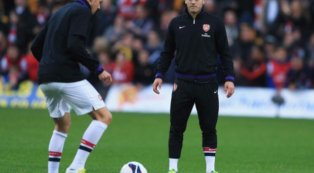 Arsenal are hoping that Jack Wilshere (right) can give the team a lift as they face QPR this weekend