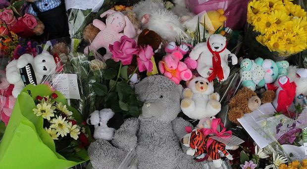 Floral tributes at the scene on the N17 Tuam Road in Galway where two-year-old Kate Gilmore and her 12-week-old sister, Grace, were killed