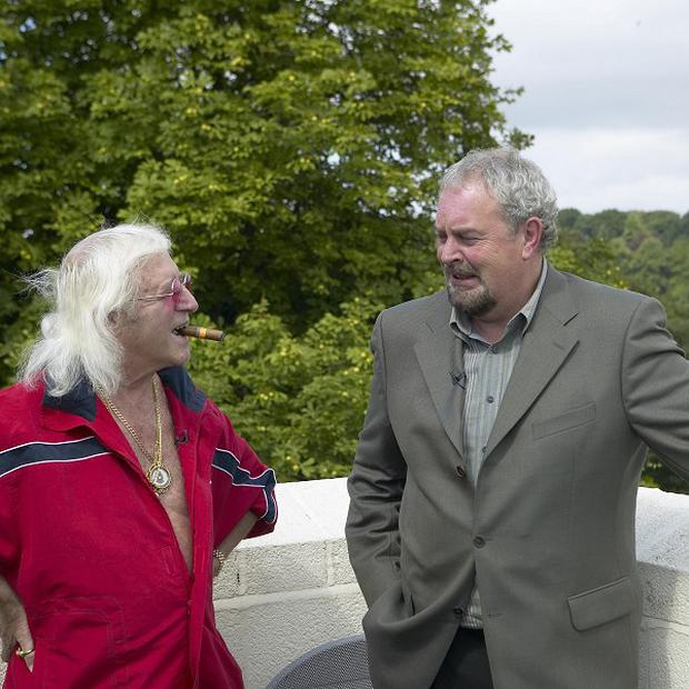DJ Jimmy Savile talks to Gerry Kelly during an interview when he denied having sex with under-age girls