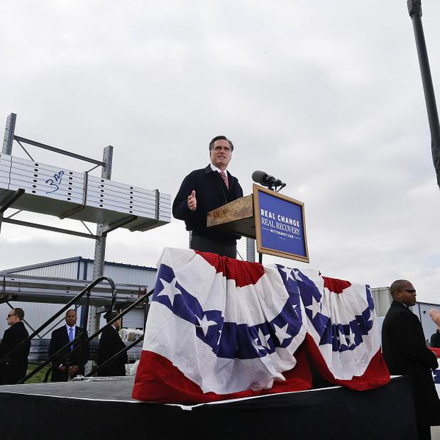 Republican presidential candidate Mitt Romney speaks about the economy at a campaign rally in Ames, Iowa (AP Photo)