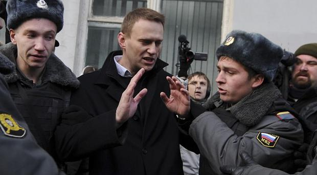 Opposition leader Alexei Navalny is detained by police in Moscow (AP)
