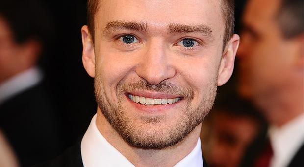 Justin Timberlake has apologised after a spoof video shown at his wedding sparked controversy