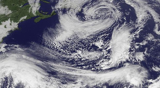 Hurricane Sandy is seen over the Bahamas with maximum sustained winds of 105mph and moving towards the north (AP)