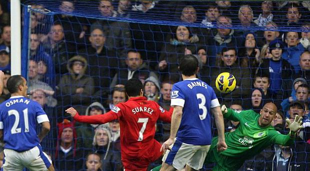 Liverpool's Luis Suarez scores late in the game but the goal is incorrectly disallowed