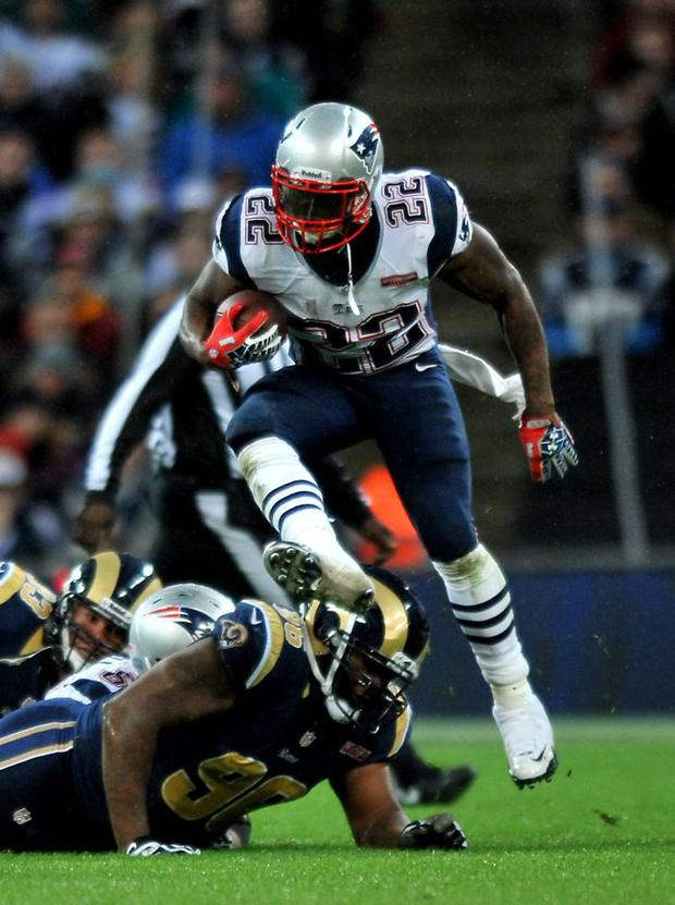 On the run: New England Patriots' Stevan Ridley jumps a tackle during their showpiece game with the St Louis Rams at Wembley