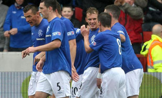 On target: Dean Shiels celebrates his goal against Clyde with team-mates