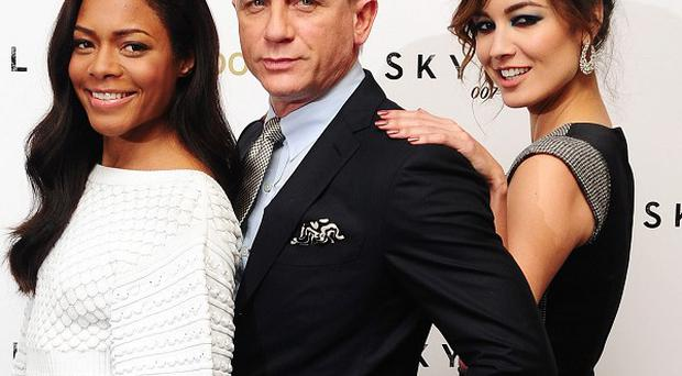James Bond stars, from left, Naomie Harris, Daniel Craig and Berenice Malohe at a photocall for the latest release Skyfall