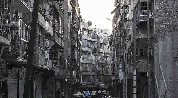 Streets in Aleppo wrecked by heavy shelling (AP)