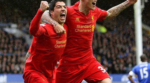 Liverpool's Luis Suarez, left, celebrates scoring his side's second goal at Goodison with Martin Skrtel