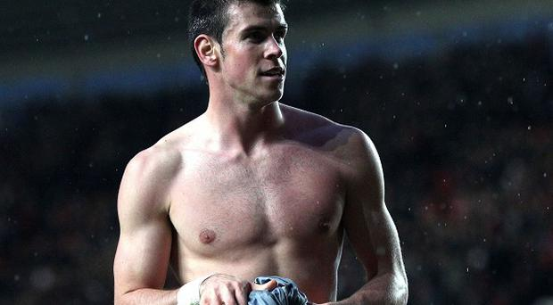 Tottenham Hotspur's Gareth Bale prepares to throw his shirt into the crowd at St Mary's