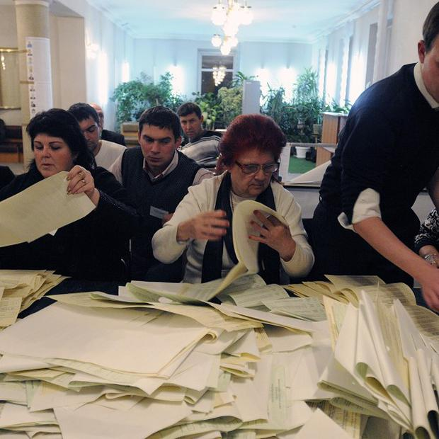 Election officials count votes at a polling station in Kiev (AP)