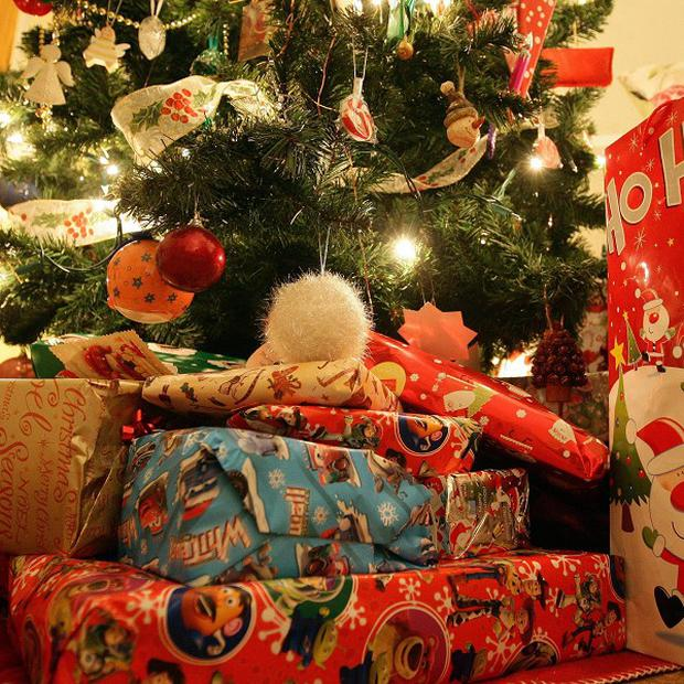 Despite many youngsters being more happy to play with the packaging than the present, parents feel pressured into buying expensive gifts