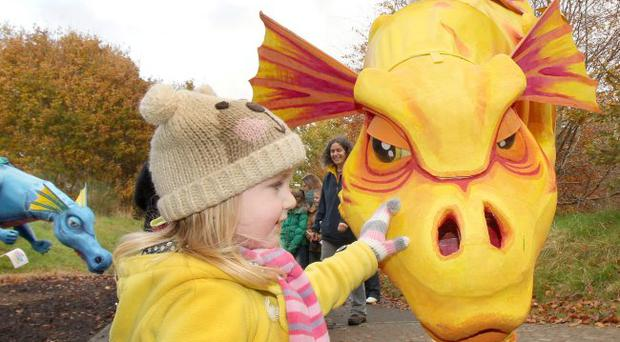 Grace Guthrie (3), from Bready, meets the dragons at the Derry Halloween Dragon Safari