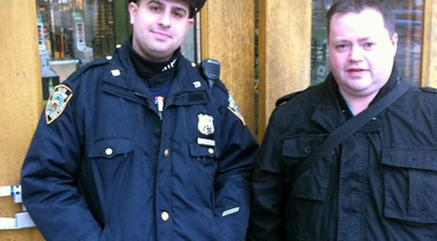 Our man Billy Weir with one of New York's finest on Monday