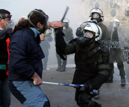 Demonstrators fight with riot police in Greece earlier this year