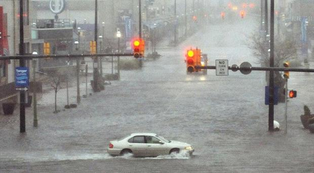 Flooding and high winds arrive along North Michigan Avenue in Atlantic City, New Jersey (AP/The Press of Atlantic City, Michael Ein)