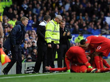 Luis Suarez After Luis Suarez's cross was deflected into the Everton goal by Leighton Baines, the striker made a bee-line towards David Moyes before tumbling to the floor in front of him.