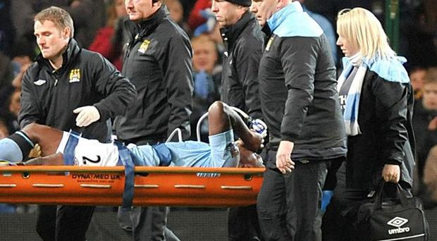 Micah Richards, centre, expects to miss 16 weeks following his knee surgery