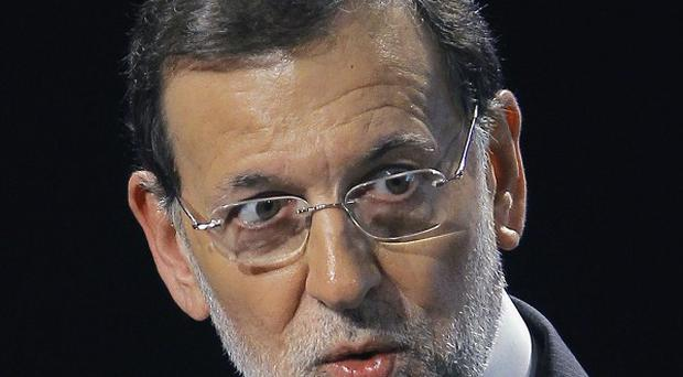 Spanish Prime Minister Mariano Rajoy said the country does not require an immediate bailout (AP)