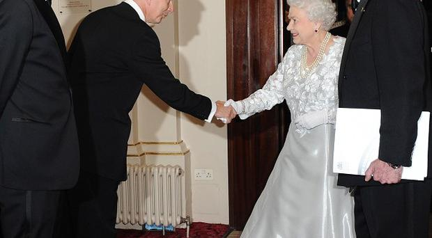 The Queen shakes hands with Simon Robey, Chairman of the Royal Opera House