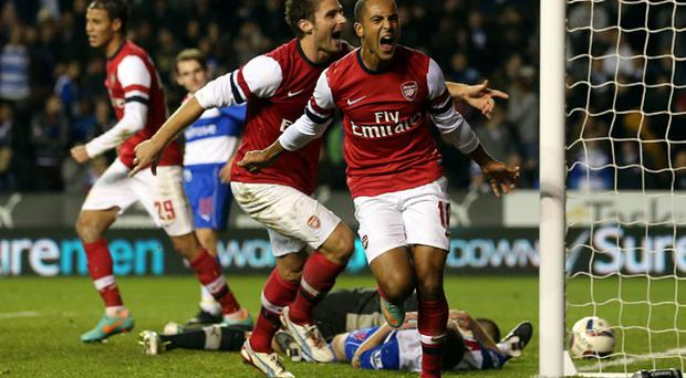 Theo Walcott of Arsenal celebrates their sixth goal during the Capital One Cup Fourth Round match between Reading and Arsenal