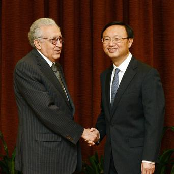 The UN-Arab League envoy to Syria Lakhdar Brahimi, left, shakes hands with Chinese foreign minister Yang Jiechi (AP)