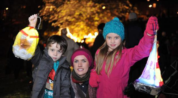 Philip Rooney 6 Rebecca Gregory and Mia Gregory 9 (left to right) at the Latern parade