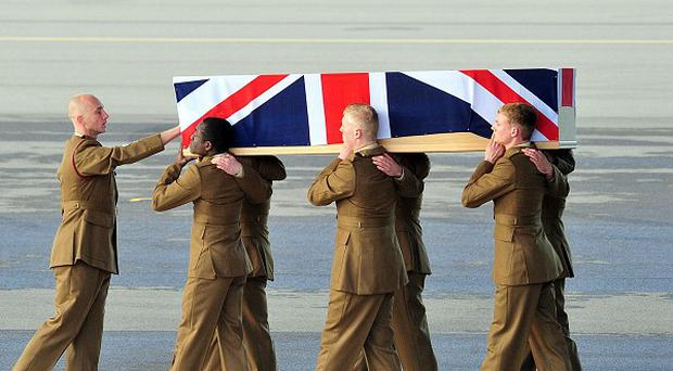 The repatriation ceremony at RAF Brize Norton of Corporal Channing Day from 3 Medical Regiment who died last week while on patrol