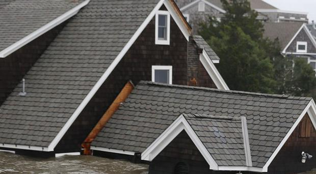 Floodwaters surround homes near the Mantoloking Bridge in New Jersey (AP)