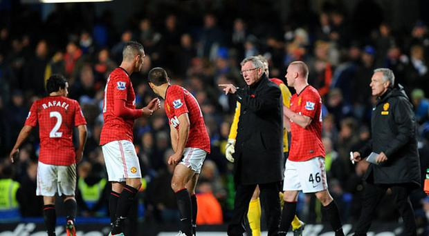 Manchester United's Federico Macheda (left) receives instructions from manager Sir Alex Ferguson before the start of extra time during the Capital One Cup, Fourth Round match at Stamford Bridge, London. PRESS ASSOCIATION Photo. Picture date: Wednesday October 31, 2012. See PA story SOCCER Chelsea. Photo credit should read: Dominic Lipinski/PA Wire. RESTRICTIONS: Editorial use only. Maximum 45 images during a match. No video emulation or promotion as 'live'. No use in games, competitions, merchandise, betting or single club/player services. No use with unofficial audio, video, data, fixtures or club/league logos.
