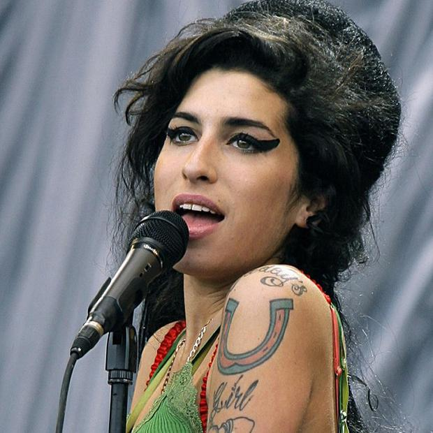 A charity auction of Amy Winehouse's dresses was expected to raise more than 100,000 pounds