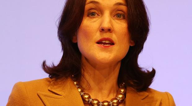 Security checks ordered by Theresa Villiers, pictured, on the report into the murder of Pat Finucane have been criticised by his family