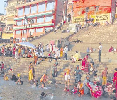 Awash with faith: those who worship in the River Ganges find comfort and strength in religion