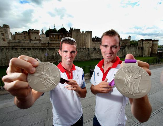 Northern Ireland's Olympic rowers Richard and Peter Chambers with the silver medals which they won in the London 2012 Olympic Games lightweight fours rowing.