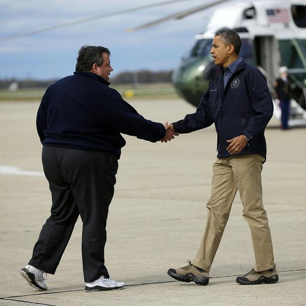 President Barack Obama is greeted by New Jersey Governor Chris Christie upon his arrival at Atlantic City International Airport (AP)