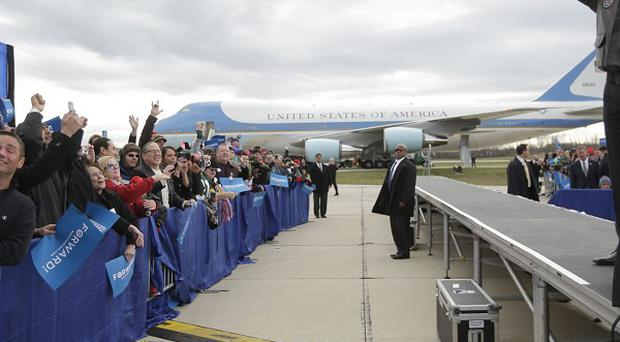 President Barack Obama waves to supporters during a campaign event at Austin Straubel International Airport in Green Bay, Wisconsin (AP)