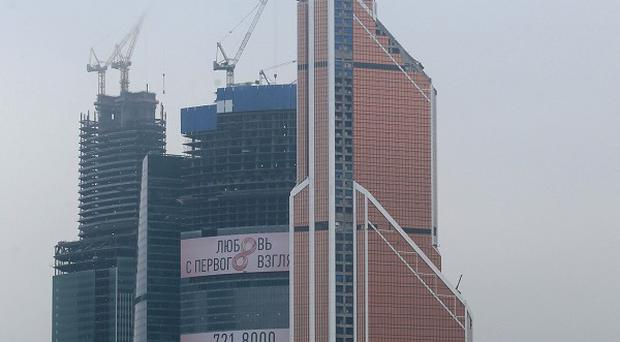 The Mercury City tower, right, is officially the tallest building in Europe at 338 metres (1,109ft) (APl)