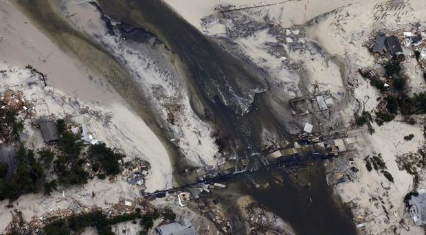 This aerial photo shows a new break in the island across Route 35 at the Herbert Street bridge in Seaside Heights, N.J