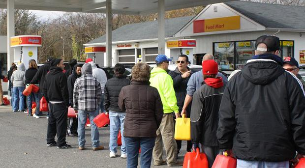 Superstorm Sandy has many disrupted fuel deliveries, causing long lines at petrol stations (AP)