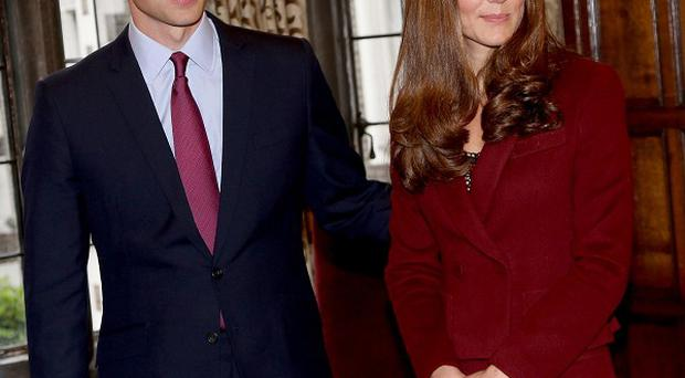 A policeman accidentally fired a gun while guarding the home of the Duke and Duchess of Cambridge