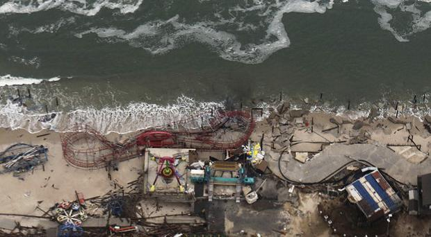 Debris from an amusement park destroyed during Superstorm Sandy lines the beach in Seaside Heights, New Jersey (AP)