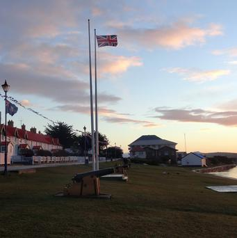The Falkland Islands flag flies alongside the Union Jack on Victory Green in Stanley, Falkland Islands