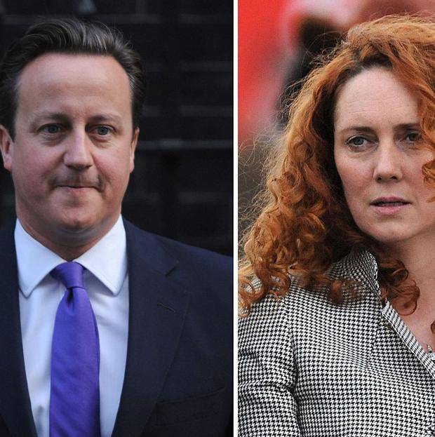 Prime Minister David Cameron was at Eton with Rebekah Brooks's husband Charlie