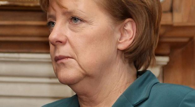 Angela Merkel says Europe's sovereign debt crisis will last at least five more years