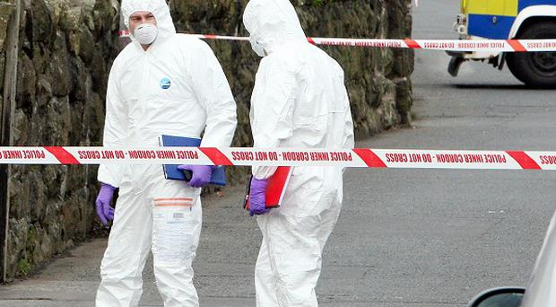 Police forensic experts at the scene of the fatal shooting in the Longlands Road area of Newtownabbey