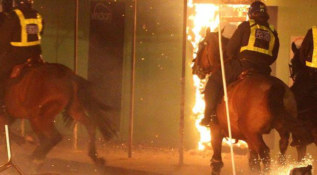 MPs have viewed a documentary focusing on the events leading up to the London riots