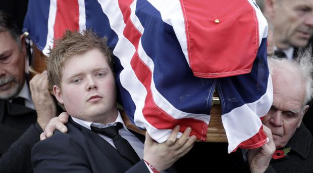 Kyle Black, left, carries the coffin of his father David Black from Molesworth Presbyterian Church in Cookstown, Northern Ireland, Tuesday, Nov. 6, 2012.