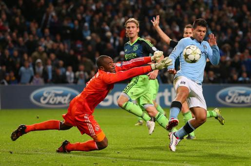 MANCHESTER, ENGLAND - NOVEMBER 06: Kenneth Vermeer of Ajax punches clear of Sergio Aguero of Manchester City during the UEFA Champions League Group D match between Manchester City FC and Ajax Amsterdam at the Etihad Stadium on November 6, 2012 in Manchester, England. (Photo by Alex Livesey/Getty Images)